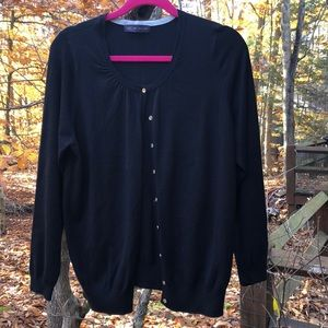 Black fine knit cardigan with petite buttons.